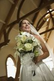 Bride holding bouquet. Royalty Free Stock Photos