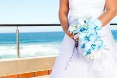 Bride holding bouquet Stock Photos
