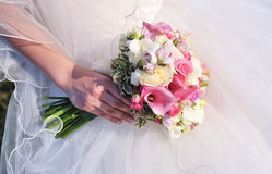 Bride holding bouquet Royalty Free Stock Images