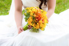 Bride holding a bouquet Stock Images
