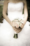 Bride holding a bouquet Stock Photos