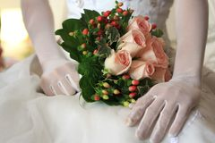 Bride holding bouquet Stock Images