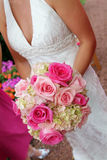 Bride holding bouquet. Half body portrait of bride holding bouquet of red and pink flowers Stock Photo