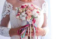 The bride is holding a bouquet. Of beautiful flowers Royalty Free Stock Photography