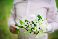 Bride holding bouquet of blossom apple tree on wedding day,. Vintage bride Stock Photos