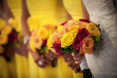 Bride Holding Bouquet with Bridesmaids in Background Stock Photos