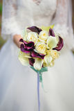 Bride holding bouquet of Calla lilies Stock Photo
