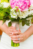 Bride Holding Bouquet of Flowers Stock Images