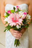 Bride Holding Bouquet of Flowers Stock Image