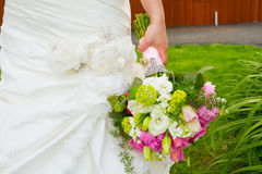 Bride Holding Bouquet of Flowers Royalty Free Stock Photo