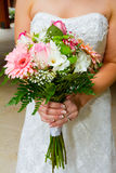 Bride Holding Bouquet of Flowers Royalty Free Stock Photos