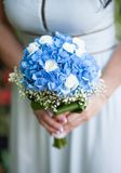 Bride holding bouquet of flowers. Stock Photography