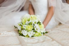 Bride holding bouquet of flowers. Royalty Free Stock Images