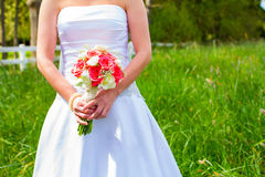 Bride Holding Bouquet of Flowers Stock Photography