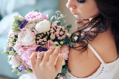 Bride holding a bouquet of flowers in rustic style, wedding Stock Photos