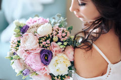 Bride holding a bouquet of flowers in rustic style, wedding Stock Photography