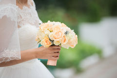 Bride holding a bouquet of flowers Stock Photo