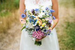 Bride Holding Bouquet of Flowers on Wedding Day Royalty Free Stock Photos
