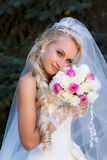 Bride holding a bouquet of hand Stock Photography