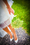 Bride holding a bouquet made of chamomile flowers Stock Photos