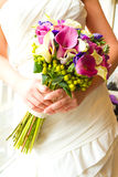 Bride Holding Bouquet of Mixed Flowers Stock Photos