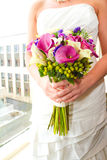 Bride Holding Bouquet of Mixed Flowers Stock Images