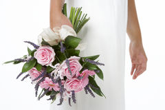 Bride Holding Bouquet Of Pink Flowers Royalty Free Stock Photography
