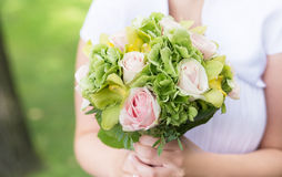 Bride holding bouquet with pink roses. Wedding Stock Image