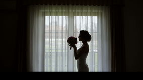 Bride holding bouquet silhouette stock footage