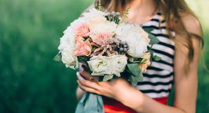 The bride holding a bouquet. Of trendy colors Royalty Free Stock Photos