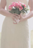 Bride is holding a bouquet Royalty Free Stock Images