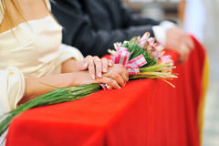 Bride holding bouquet during wedding ceremony Royalty Free Stock Photos