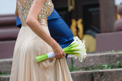 Bride holding bouquet of white calla lilies.  Stock Photos