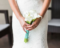 Bride holding a bouquet of white callas Stock Photography