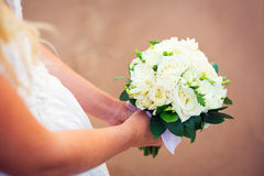 Bride holding bouquet of white flowers Royalty Free Stock Photos