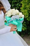 Bride Holding Bouquet of White Roses Royalty Free Stock Images