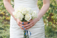 Bride Holding Bouquet of White Roses Royalty Free Stock Photography