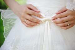 Bride holding a bow Royalty Free Stock Image