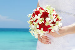 Bride holding bridal bouquet on natural sea background royalty free stock images