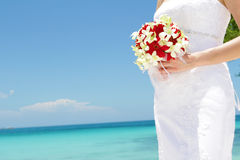 Bride holding bridal bouquet on natural sea background Stock Image