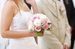 Bride holding bride bouquet Stock Image