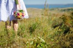 Bride holding bright wedding bouquet Stock Image
