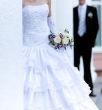 Bride holding bunch of flowers Royalty Free Stock Images