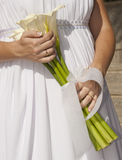 Bride holding a bunch of flowers Stock Images