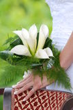 Bride holding calla lilly wedding bouquet Stock Photography