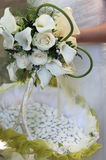 Bride holding calla lilly and white roses wedding bouquet Royalty Free Stock Image