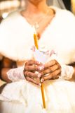 Bride holding the candle during the wedding ceremony Royalty Free Stock Photography