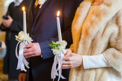 Bride holding candles. eremony in church. Traditional moment. Stock Images