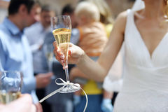 Bride holding champagne glass Royalty Free Stock Photo