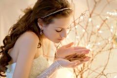 Bride holding cinamonn Royalty Free Stock Photography